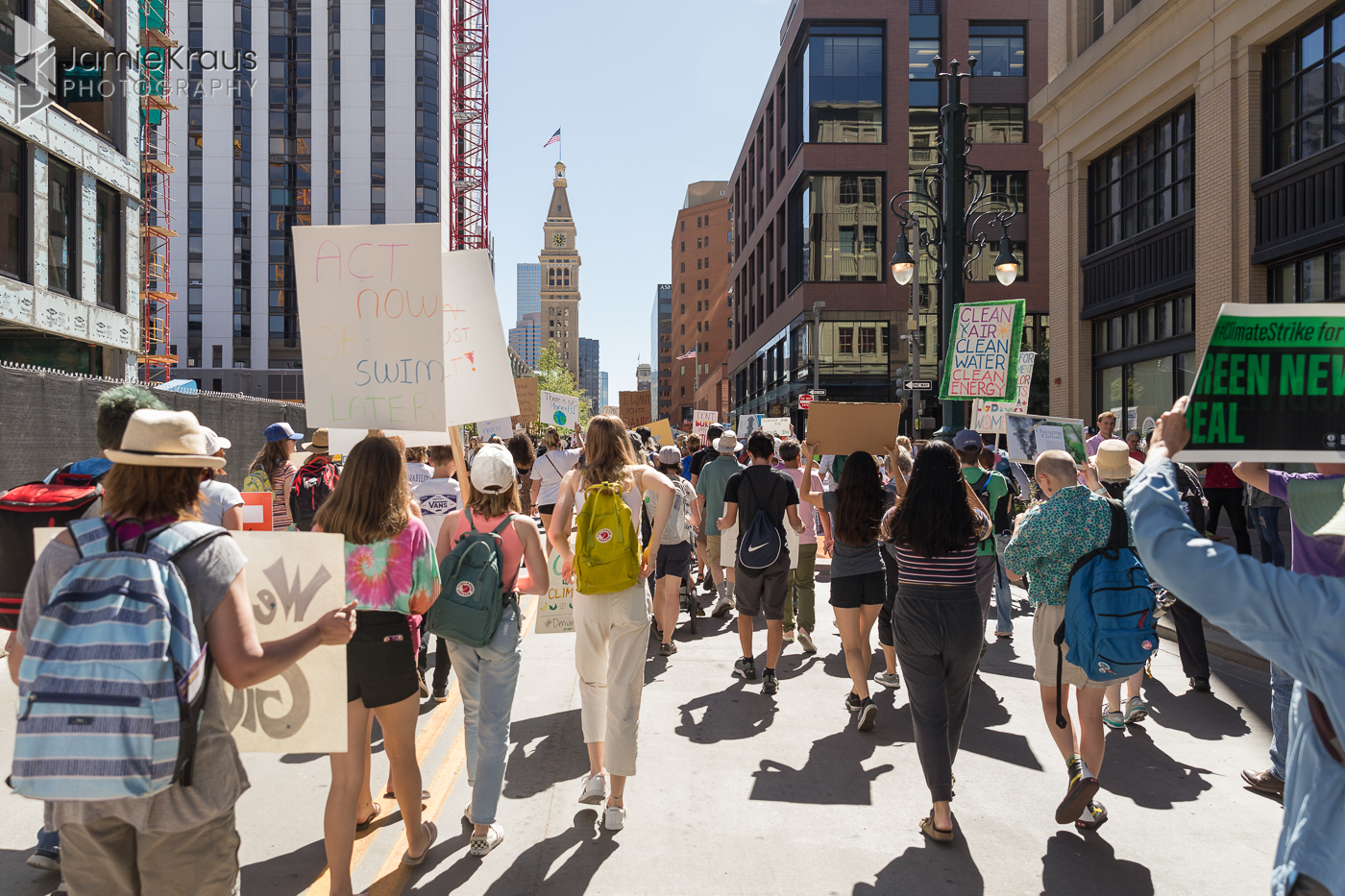 protesters walk down 16th st mall during Global Climate Strike